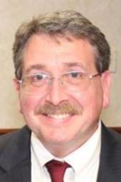 Commissioner Christopher Fischer